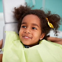 Little girl smiling in dental chair