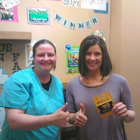Patient and team member with Regal giftcard