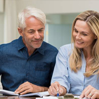 Senior man and woman reviewing paperwork