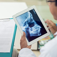 Dentist looking at skull x-ray