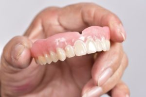 Holding dentures
