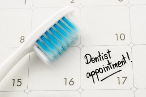 a calendar with a dentist appointment reminder on it