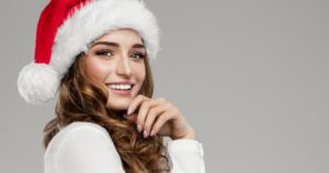 Smiling woman in a Santa hat